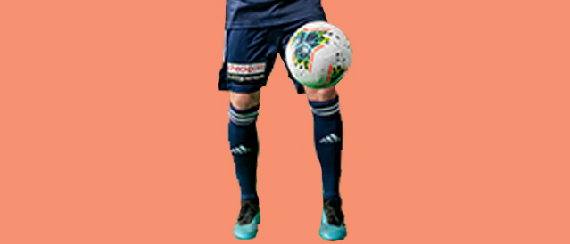 Melbourne Victory player and soccer ball on an orange background